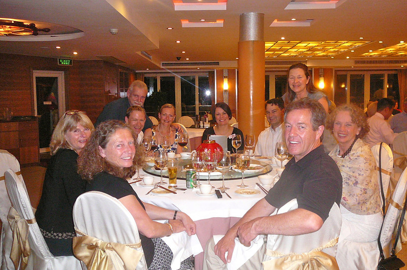 "There we are with some of the gang enjoying one of our many great meals on the ""Sun""... after eating this way in China night after night it makes us want to go buy a round table and buy a ""Lazy Susan""... fun!! :-)"