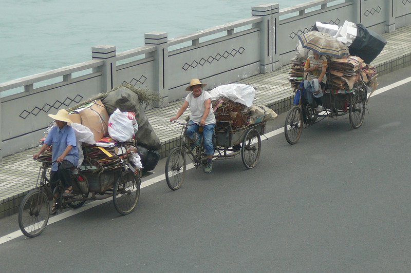 A common site in China... no F-150s or Dodge Durangos needed here... as long as you have a good bike your transportation needs are taken care of.   :-)