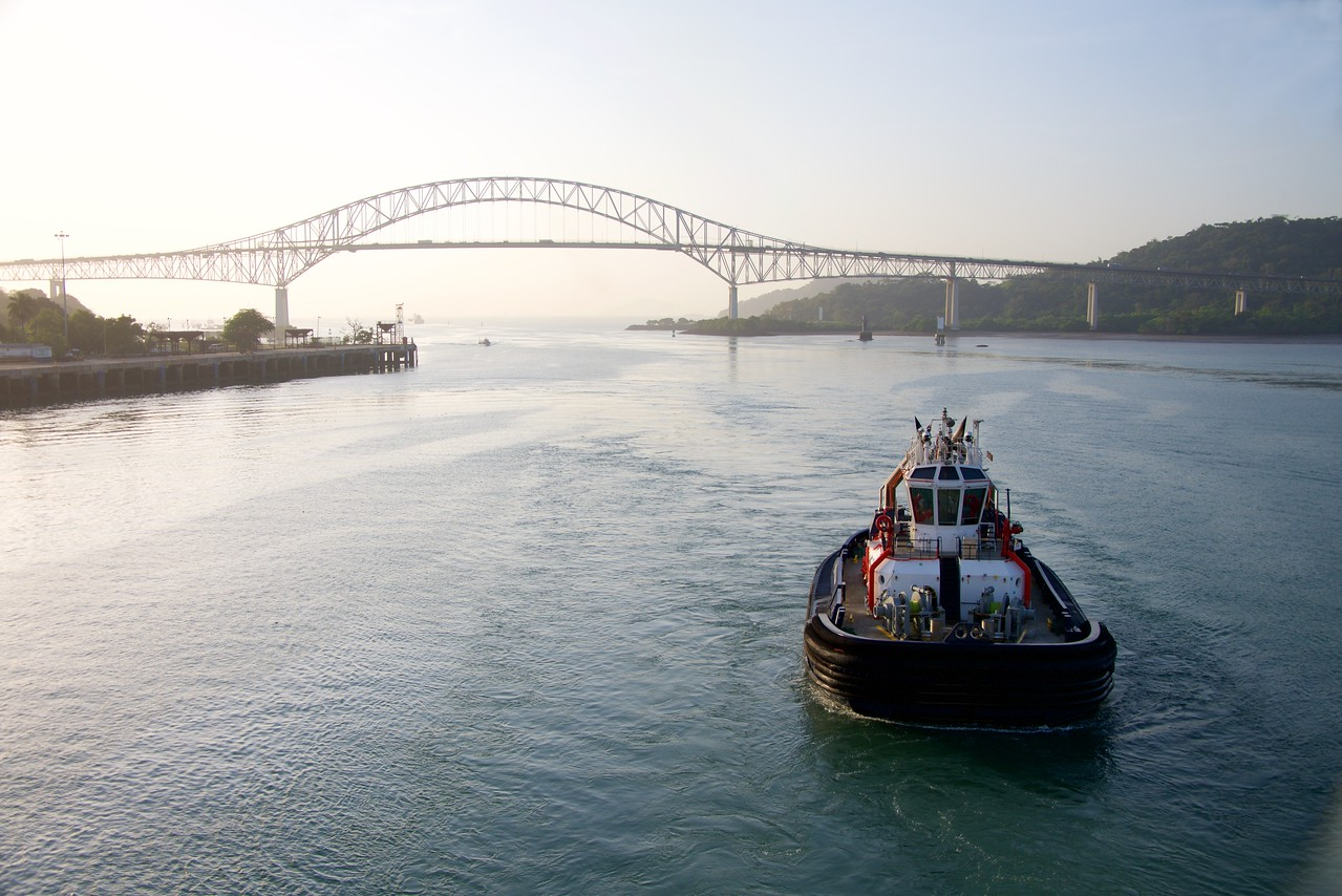 Our tug boat guides us under the Bridge of The Americas