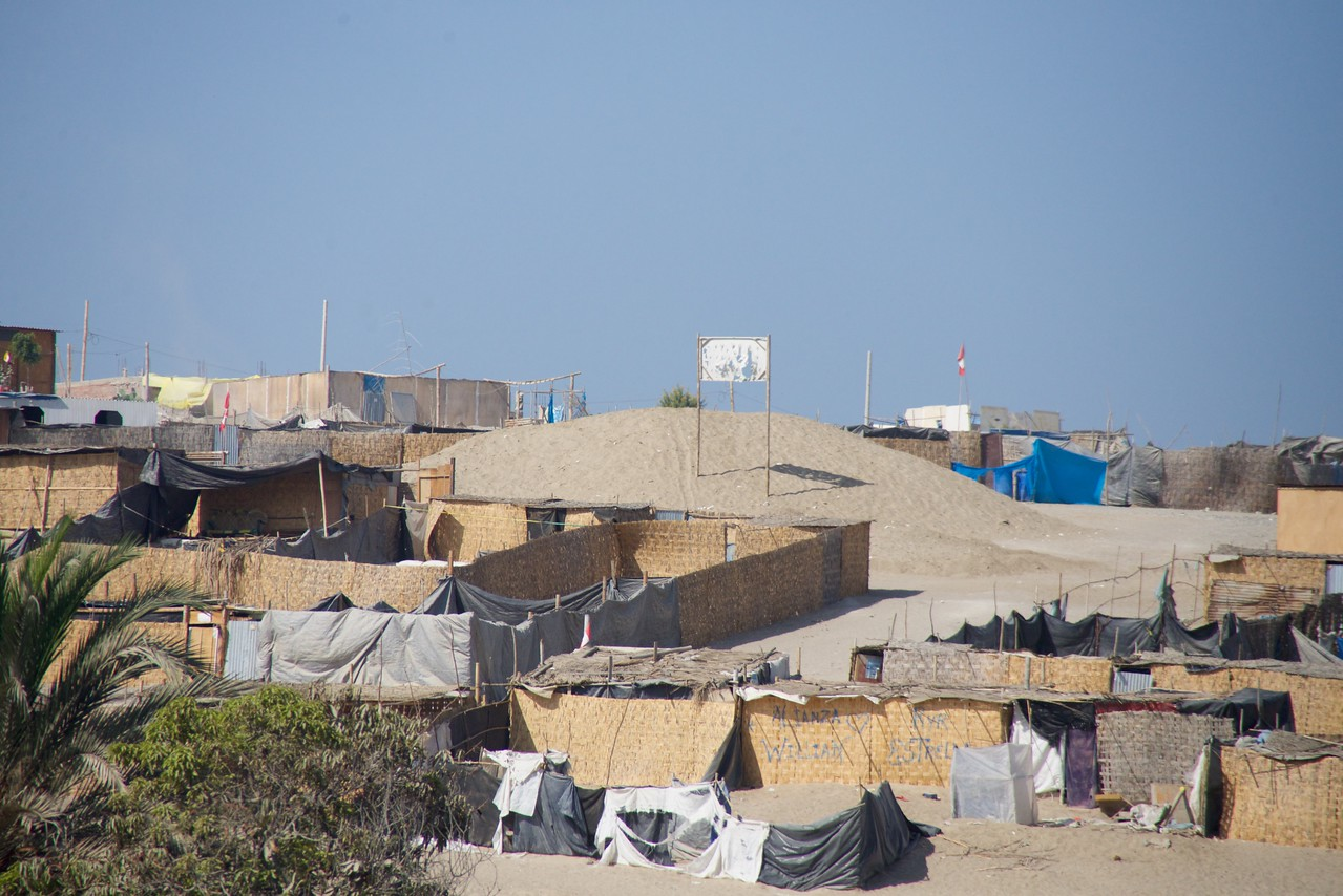 """This is what is known as a""""Young Town""""  Temporary houses that evolve from """"mud"""" to """"wood"""" to """"adobe"""" to """"cement"""""""