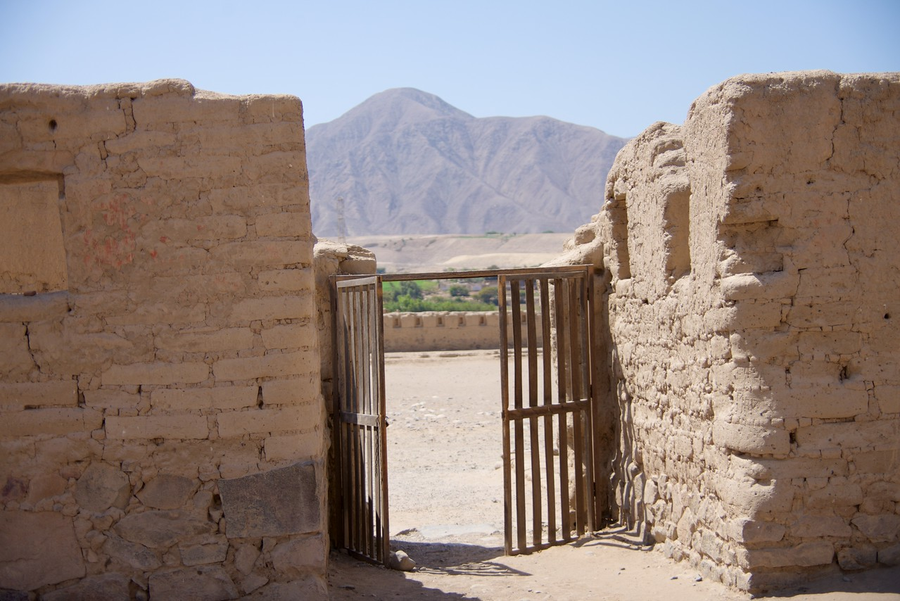 Looking through door of the Interior of the Palace outside  It is significant that the Mountain is in line with the door  Mountain was thought to be a protector by the Incas