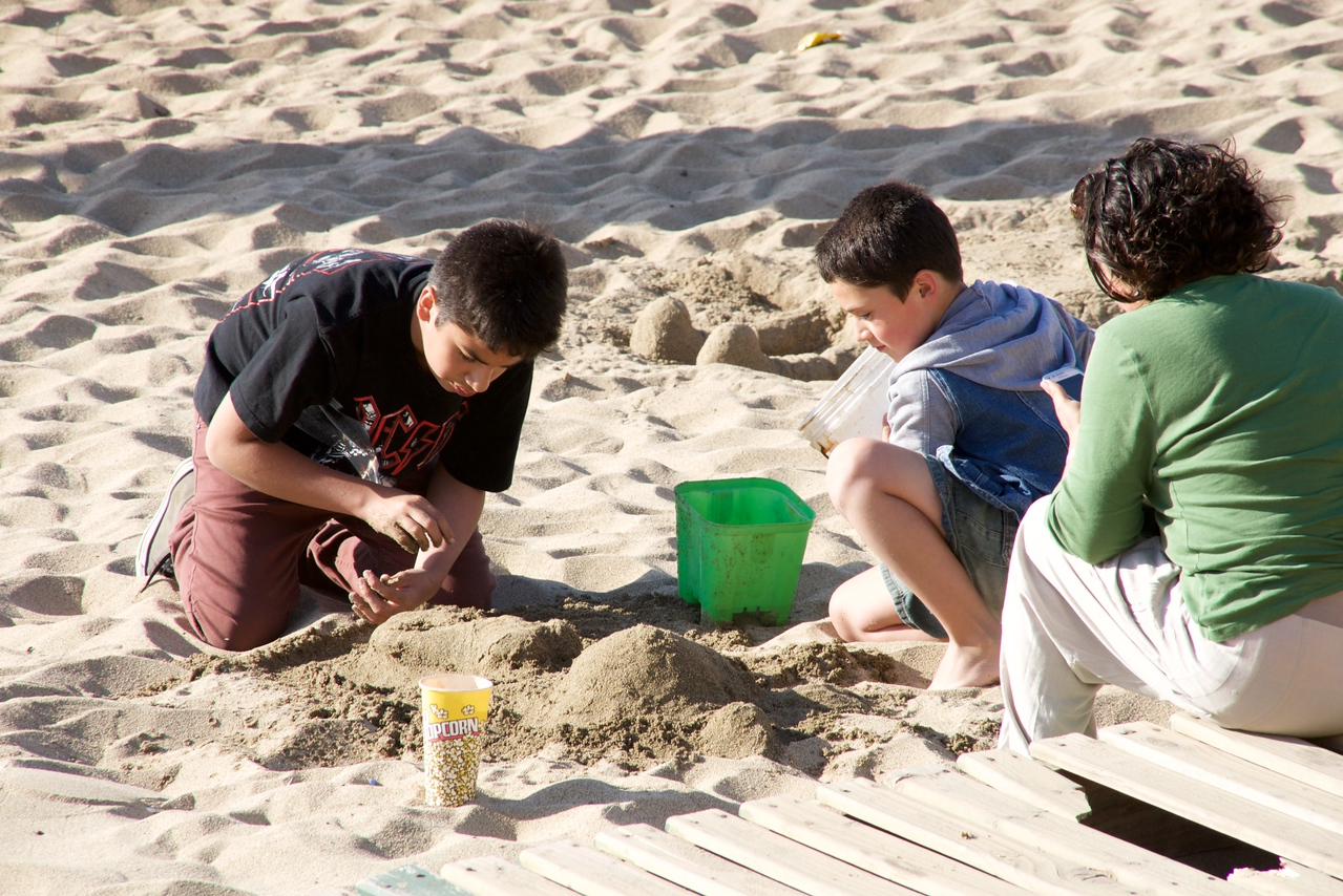 Working on Their Own Sand Sculpture