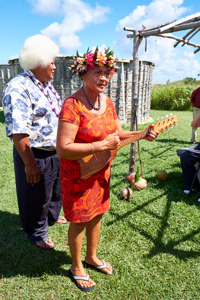 Playing the ukulele and singing a traditional song about the frangipani.