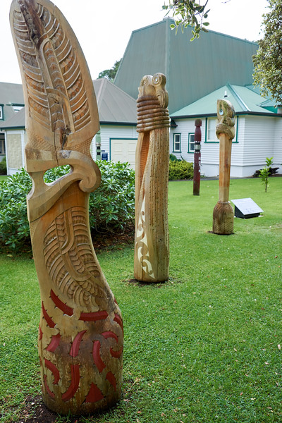 The carved pou depict points of illumination in the life of Tamati Waka Nene, a high ranking chief of people in Hokianga. These three represent his father, his mother and his birth into the Maori world.