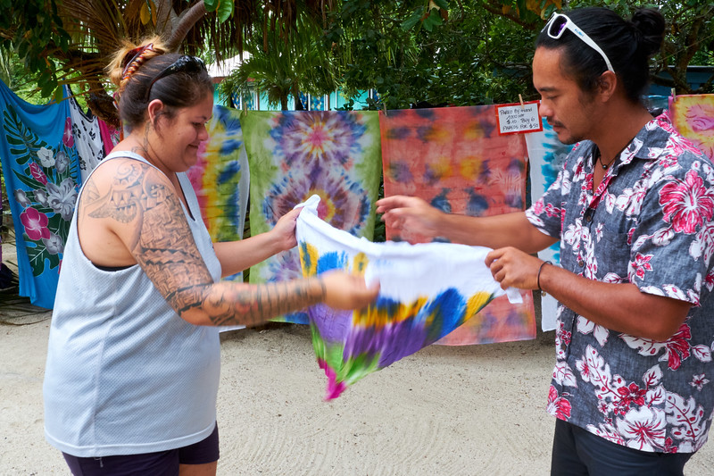 Dye painting with varying colors derived from tropical flowers. The fold of the cotton fabric determines the dye pattern.