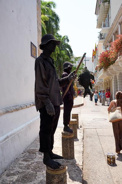 Living statues posing for money.