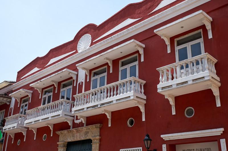 Cement balconies are not original.