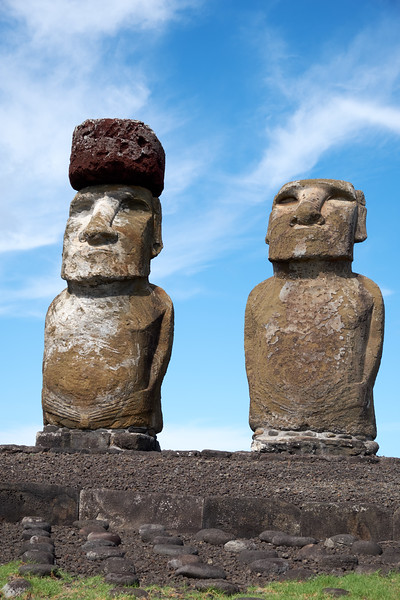 Main stone at Rano Raraku is tuff, a soft volcanic rock. The hats or top knot is carved of red scoria.