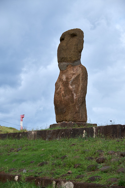 Moai at the tender pier. Moai are enormous Easter Island heads that symbolize the ancient traditions of Rapa Nui, the native culture of Easter Island. The Moai always look inland to protect the people.