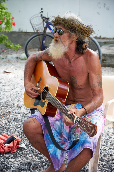 This man played traditional music while his friends sold coconuts in their front yard.