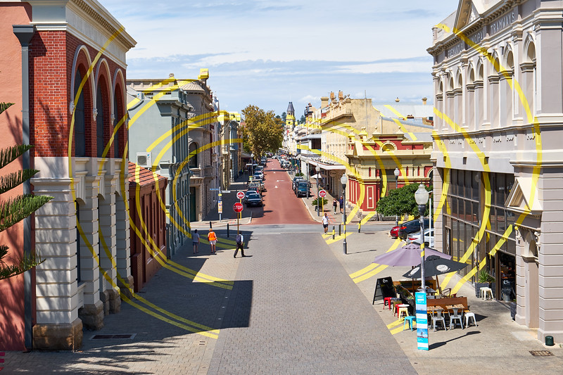 Quaint Fremantle with a modern twist. The yellow lines were painted on the buildings and sidewalk all the way to the yellow steeple (in the center rear).