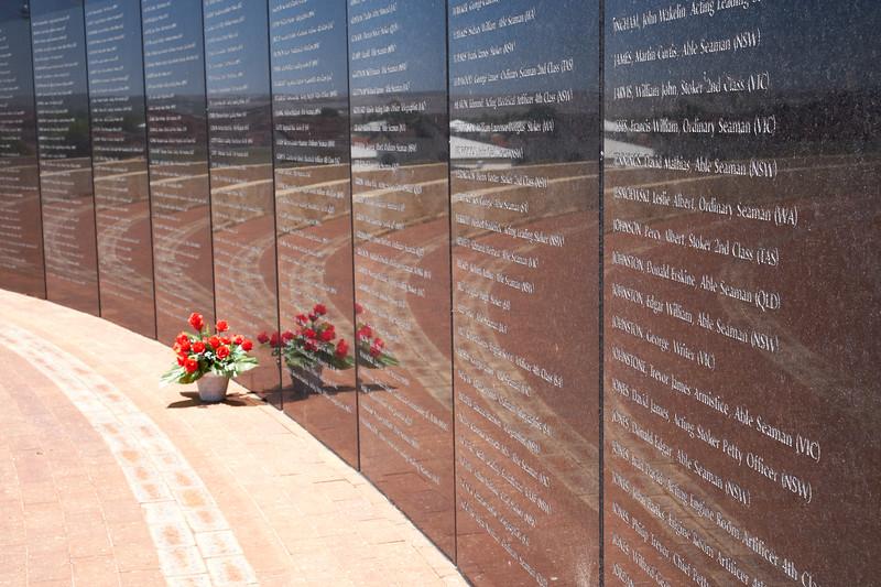Black Granite semi-circular walls engraved with the names of the 645 men lost.