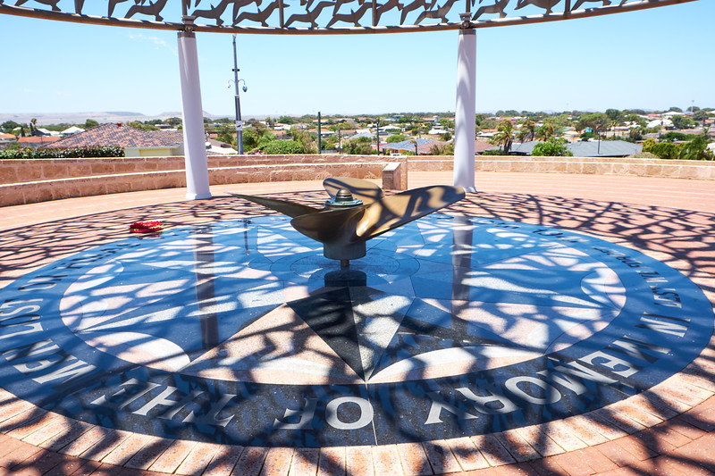 The circular granite Sanctuary Floor or Podium with graphic images of ship's prow and the silver gull motif. Ship's propeller serves as a ceremonia.