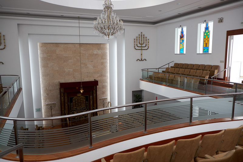 View from the women's section of Socidad Isrealita Sefaradi. The stain glass window are the 12 Tribes of Israel.