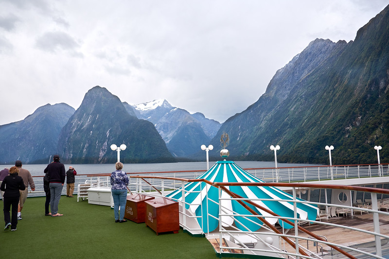 Fresh snow the night before on some of the mountain peaks in Milford Sound.