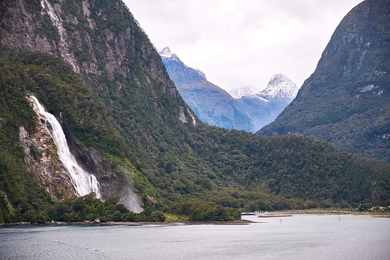 The end of Milford Sound on an overcast day, early morning.