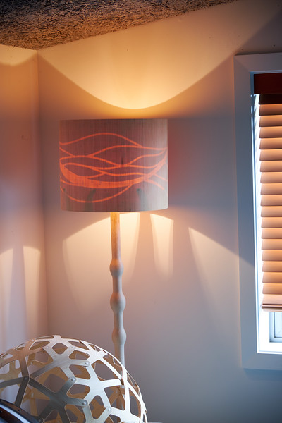 This lamp shade is designed to reveal a hidden pattern when turned on. By day it is a smooth cylinder drum.