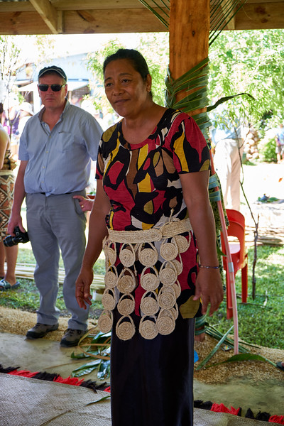 The woman is wearing a kiekie is a waist girdle. A more modern vesion of the ta'ovala that allows women to move more freely. It is not worn on special occasions like weddings or funerals.