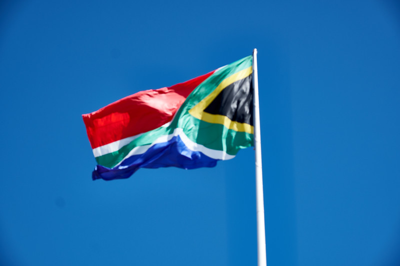The largest South African Flag in the country. It is the size of half a tennis court. Green for land, blue for ocean, red for blood spilled in freedom fight, white for white people, black for black people and gold for country's resources.