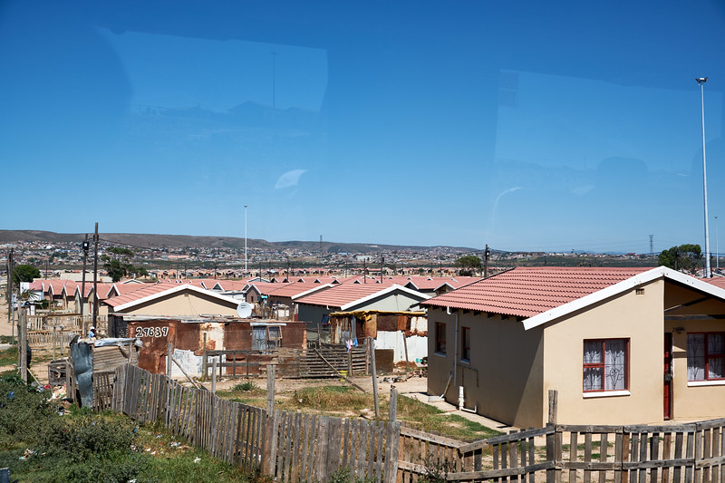 Missionvale cement houses built by Mandela after 1994. There are obviously not enough of these due to government corruption. (from bus).