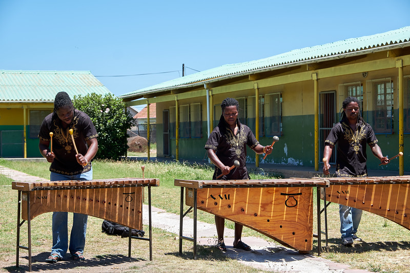 Another band plays xylophone and sing.