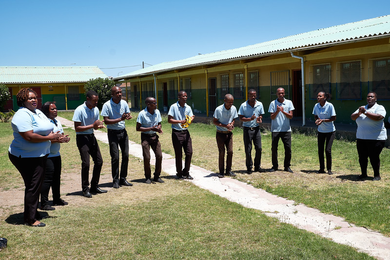 Local singing group performs for us.