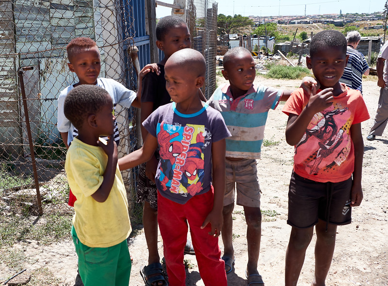 Children of Rhamaphosa Village, a squatter camp, greet our bus.