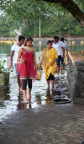 People coming out of Gran Bassin, sacred crater lake, at Sagar Shiv Madir Temple.