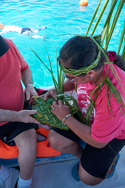 Showing us how they weave baskets out of pandanus leaves.