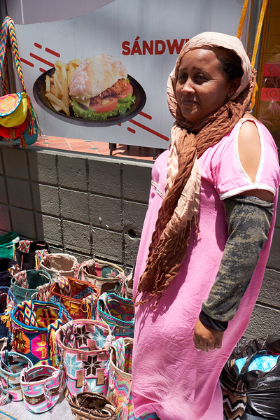 The Wayuu Natve American Indian lives in northern Columbia and northwest Venezuela. This woman is selling her bags or mochilas.