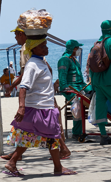 This woman was carrying her goods on her head down the beach.