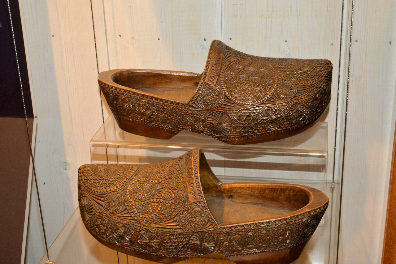Wedding Clogs… Man Carves The Shoes With Her Name Across The Top and Gives Them To His Fiance When She Accepts His Proposal She Wears Them On Her Wedding Day.