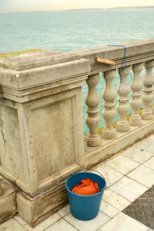 Fishermen Set Up Stations Like This Along the Sea Wall.