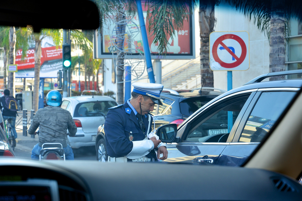 Policeman Giving A Ticket… Checking Identification.