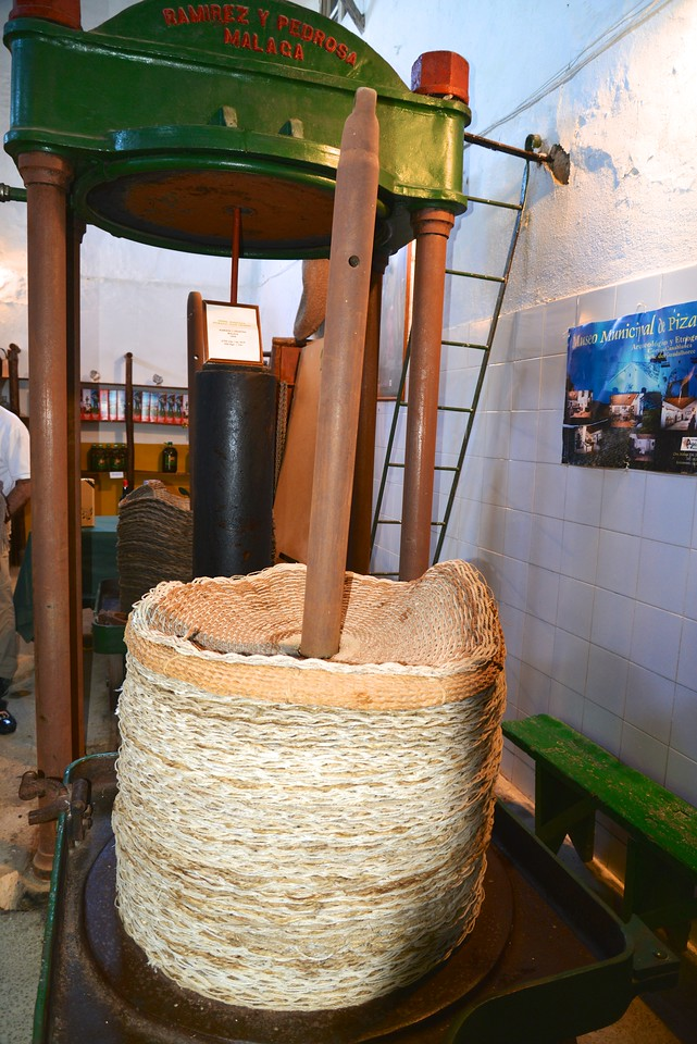 Rope Baskets Filled With Crushed Olive Paste and Then Moved… Iron Piston Column Raised… Baskets Placed Under Piston… Piston Lowered For The Second Crushing…Takes 5x Weight To Get Oil Out of Olive Paste.