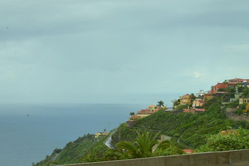 Homes Built Along Coast Cliff.