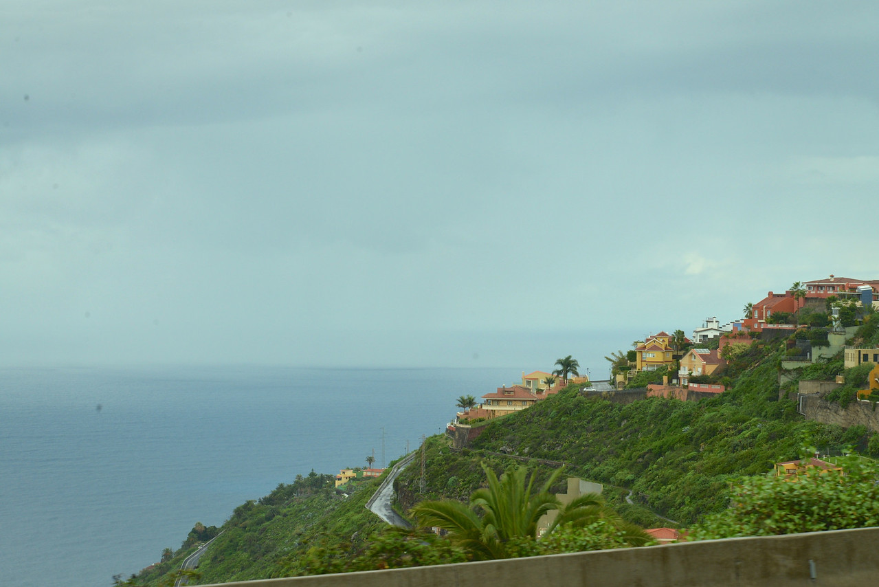 Homes Built Along Coast Cliff.