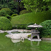 Japanese stone lantern on the opposite side of the pond.