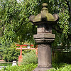 This Komatsu stone lantern marks the main entrance to the Japanese Hill-and-Pond Garden.  In 1652, the lantern was dedicated to the Tokugawa shogunate by one of the feudal lords, Naito Bunzen-No-Kami Nobutero.  A gift to New York in 1980 from sister-city Tokyo, the lantern is 10 feet (3m) tall, weighs 3 tons, and is over 350 years old.
