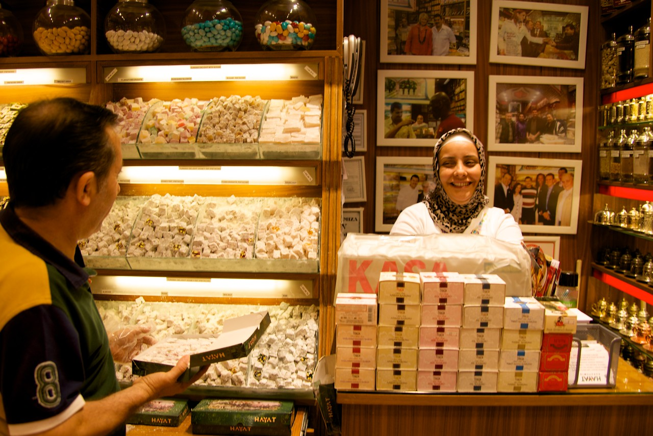 Man Is Packaging Assorted Boxes of Turkish Delight… She Is The Cashier