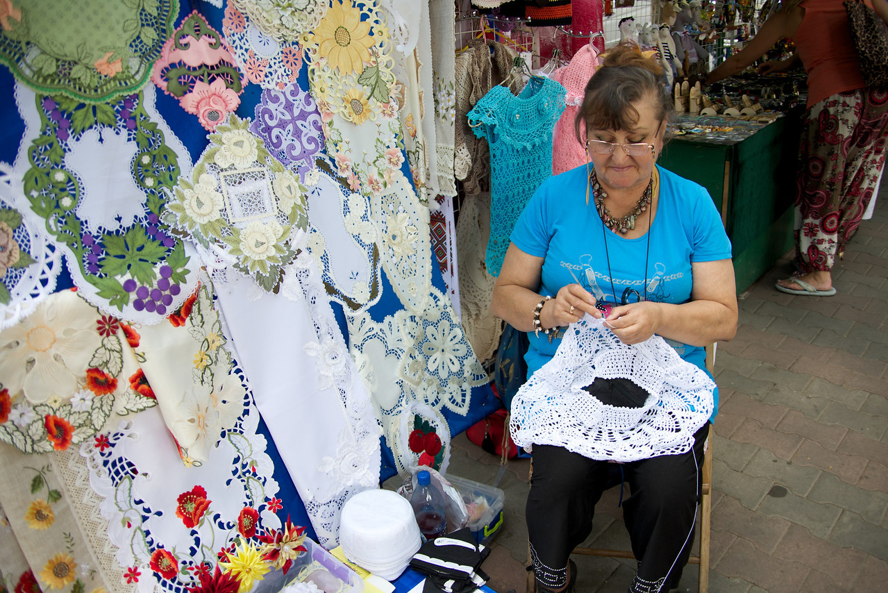 This Lady Crocheted Many of The Goods She Sold… Here She Is Making A Dress for A Doll