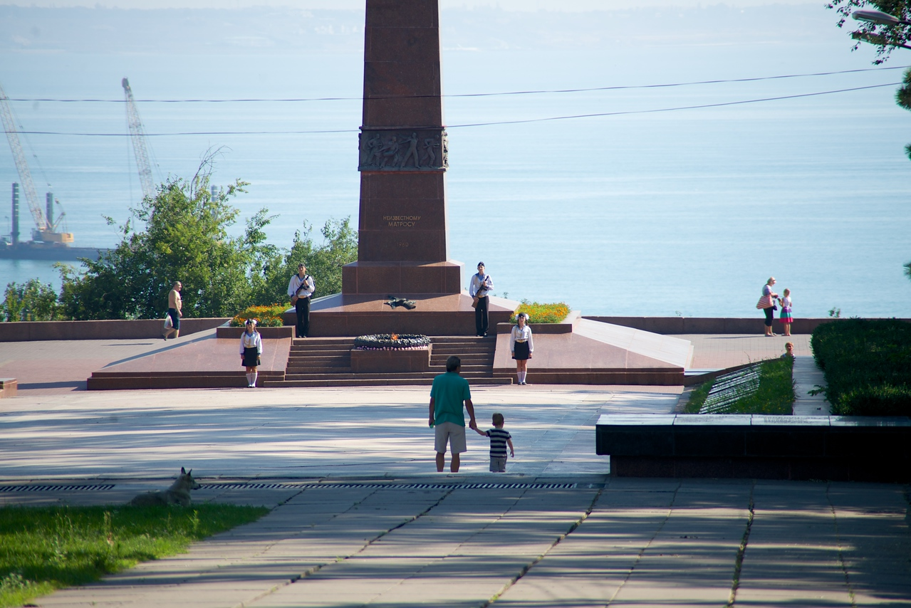 Children and Sailors Stand Guard at Monument to Unknown Sailor