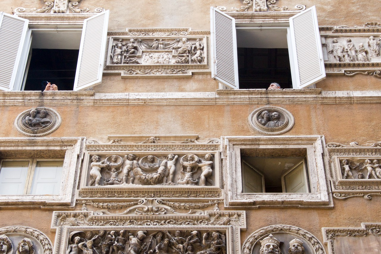 Roman Art Decorates Side of Apartment Building… People In The Open Windows