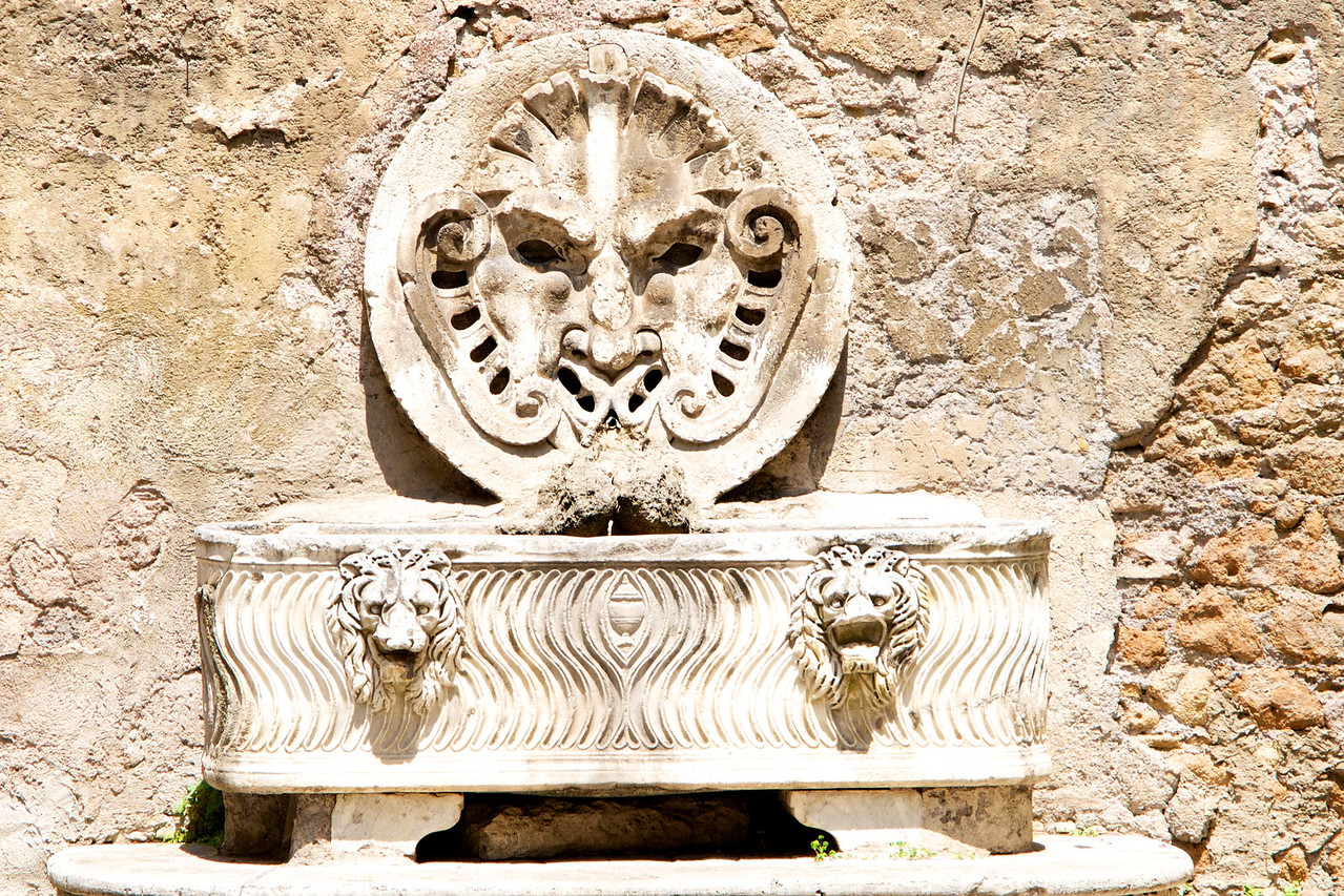 Original Roman Coffin Used As Base of Water Fountain