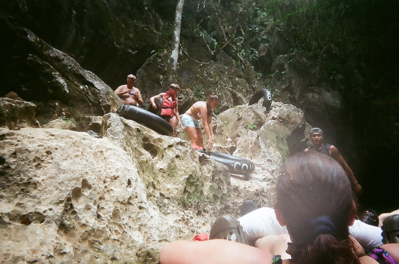 People getting into the water for the cave tubing excursion