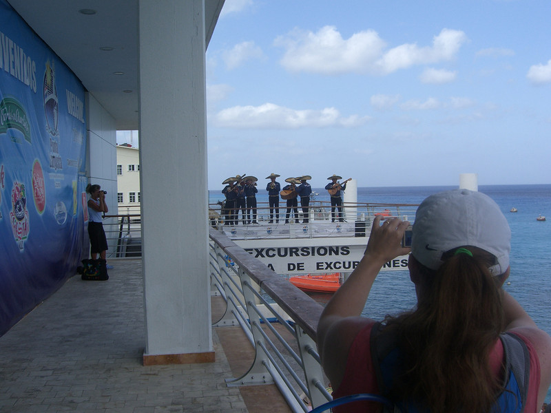 Sheila takes a picture of the mariachi band at the port in Cozumel