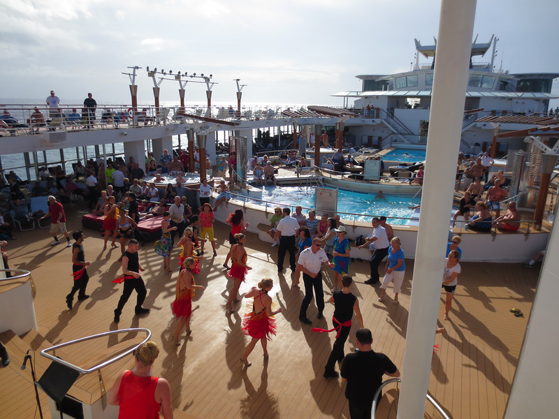 Celebrity Infinity Pool or lido deck, dancers and crew entertaining us and getting others involved.