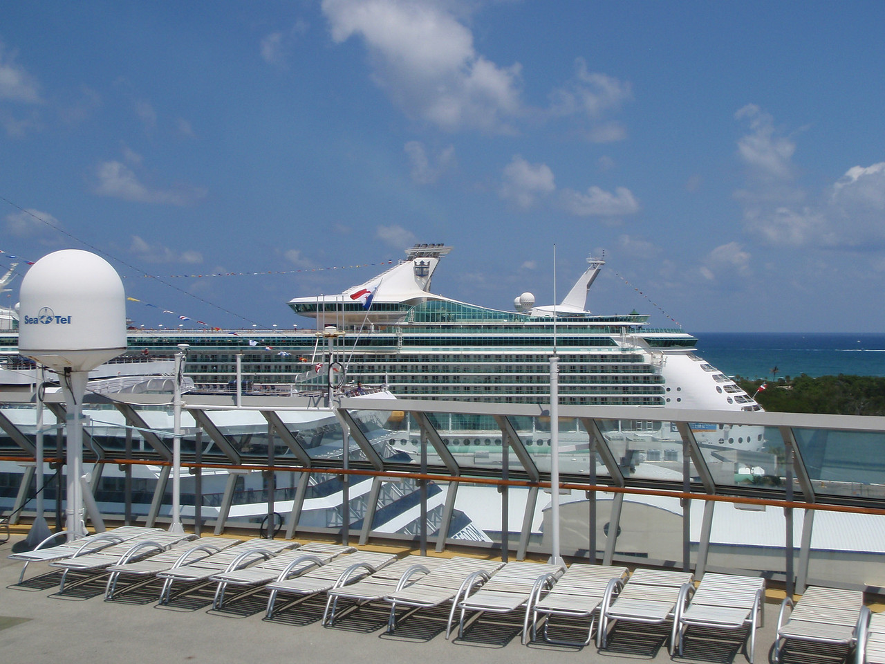 There's a glimpse of number 6 - Navigator of the Seas.  She's docked on the other side of Carnival Freedom.