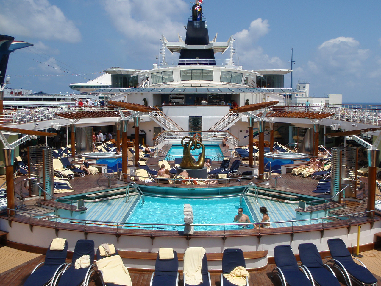 We took a quick stroll around the ship after dropping off our carry-on luggage in our cabin.  It did not take long for people to start using the pool deck.