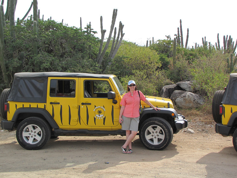 Sheila poses with our jeep at our first stop - the Cassibari Rock Formation.